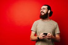 Happy Man With Beard Using Pho...