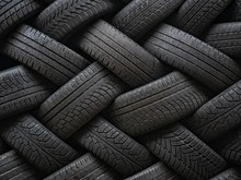 Used Auto Tires Stacked In Pil...