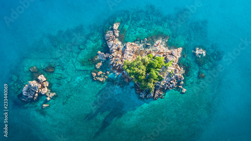 Ile Tropical island with sea and palm taken from drone. Seychelles aerial photo. St Pierre Island