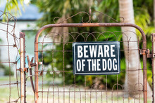 Beware Of The Dog Sign On Clos...