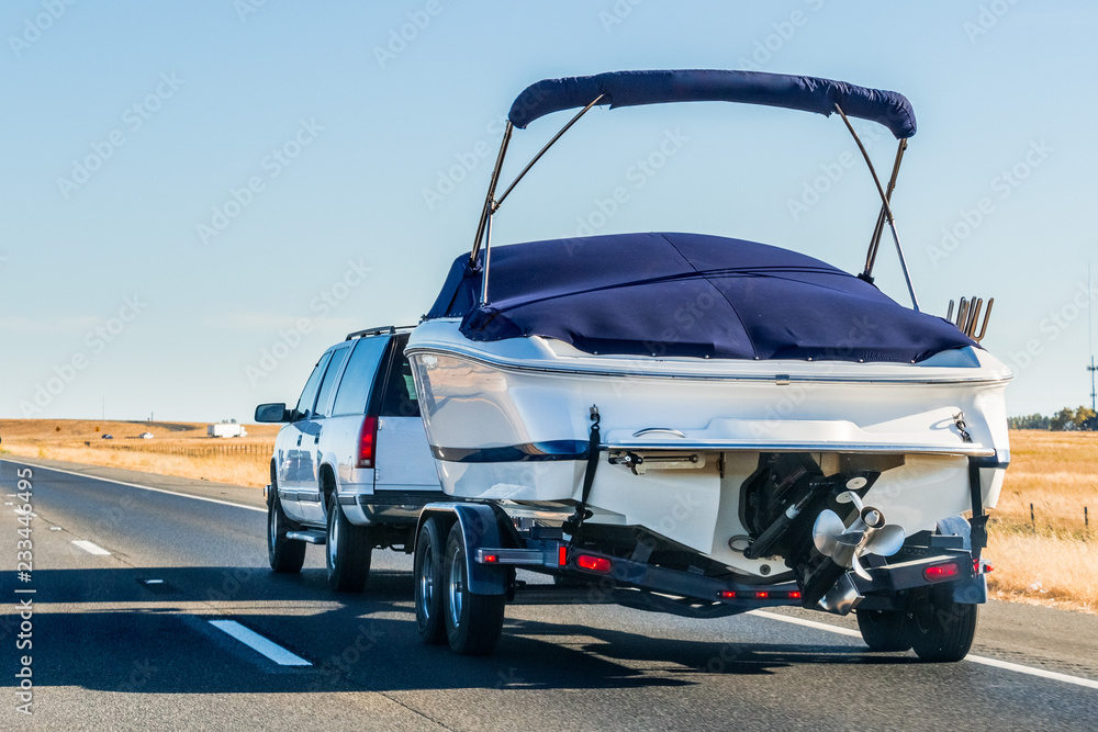 Fototapety, obrazy: Truck towing a  boat on the interstate, California