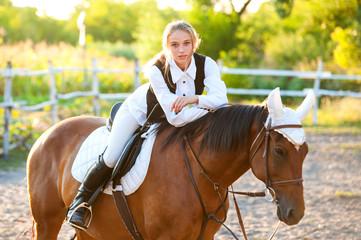 Girl equestrian rider riding a beautiful horse. Horse theme