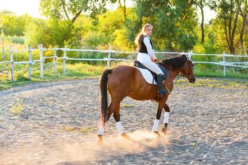 Fototapeta Girl equestrian rider riding a beautiful horse. Horse theme