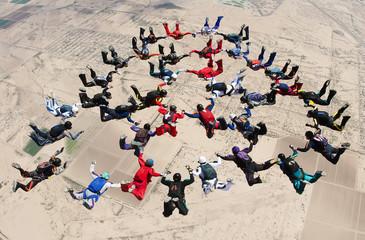 Fototapeta Skydiving big group formation