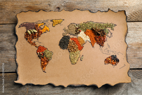 Foto op Canvas Aromatische Paper with world map made of different aromatic spices on wooden background, top view