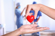 canvas print picture - Doctor giving red heart to patient, closeup. Donation day