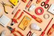 canvas print picture - Flat lay composition with electrician's tools on color background