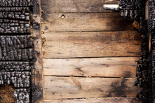 Brown Burnt Wall Of House Of Wooden Planks With Embossed Texture. Background For Copy Space. Concept Of Loss Of Real Estate Or Home. Property Insurance