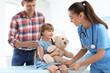 Leinwandbild Motiv Children's doctor examining little girl near parent in hospital