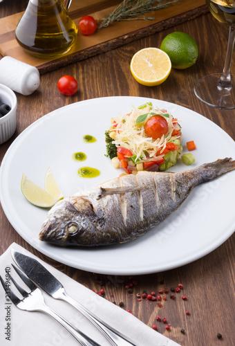 Fotografie, Obraz  Grilled dorado fish served with vegetable salad