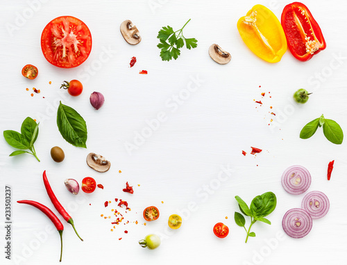 Cadres-photo bureau Pizzeria The ingredients for homemade pizza on white wooden background.