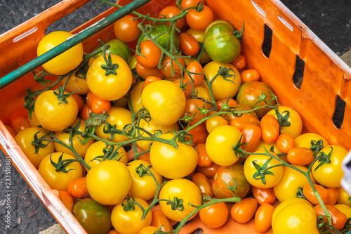 Variety of tomatoes on display at Broadway Market in Hackney, East London Wallpaper Mural