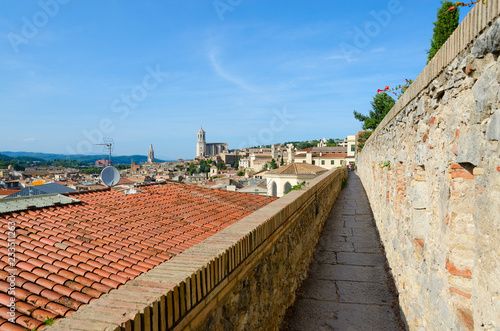 Old city walls in historical center of medieval Girona, Spain