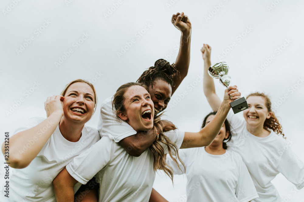 Fototapety, obrazy: Female football players celebrating their victory