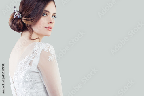 Perfect young woman with makeup and bridal hairstyle Fototapete