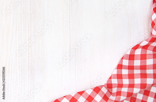 Fotografie, Obraz  Kitchen red checkered table cloth frame on white wooden empty space background