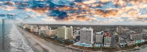 Fototapeta Aerial panoramic view of Myrtle Beach skyline and coastlline at sunset, South Carolina obraz