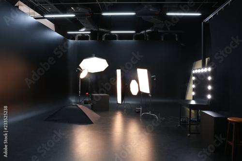 Leinwand Poster Interior of modern photo studio with professional equipment