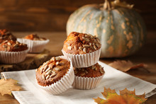 Tasty Pumpkin Muffins With Sunflower Seeds On Wooden Table