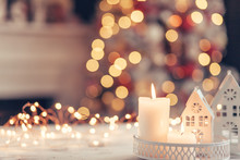 Christmas Decoration On A Table Over Blurred Lights