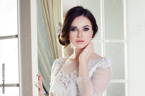 Fototapeta Perfect woman bride with makeup and bridal hairstyle, beautiful female face clos