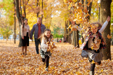 Happy Family Is In Autumn City...