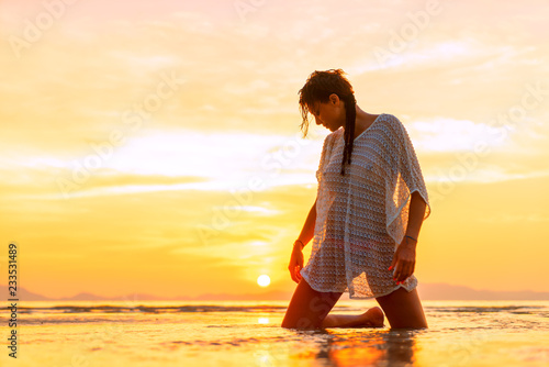 plakat Beautiful Woman at the beach in Thailand at sunset