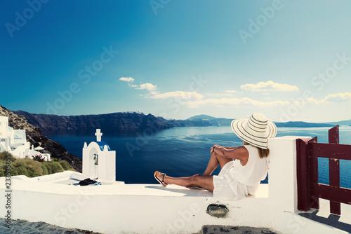 Fototapeta Luxury travel vacation woman looking at view on Santorini island obraz