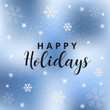 Text Happy Holidays on blue lights bokeh background.