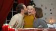 Parents kissing smiling daughter, Xmas decorations sparkling, portrait effect