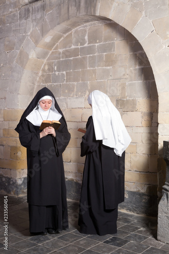 Two nuns in an old convent Canvas Print