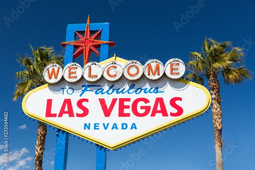 In de dag Las Vegas landmarks concept - welcome to fabulous las vegas sign and palm trees over blue sky in united states of america