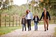 Leinwandbild Motiv Family On Autumn Walk In Countryside Together