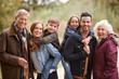 Leinwandbild Motiv Portrait Of Multi Generation Family On Autumn Walk In Countryside Together