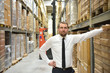 portrait of a successful businessman in a suit in the warehouse of a forwarding agency