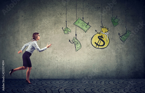Stampa su Tela Business woman motivated by money hanging on a fishing hook.