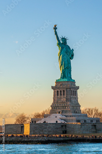 Statue of liberty vertical during sunset in New York City, NY, USA - 233574204
