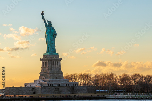 Fotografie, Obraz  Statue of liberty horizontal during sunset in New York City, NY, USA