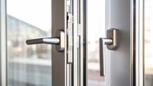 Close Up View Of Aluminum Door Window, Blurry Background