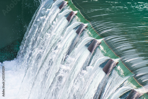 Detail of a dam with flowing water Fototapet