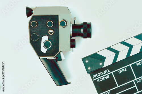 Old movie camera and clapperboard