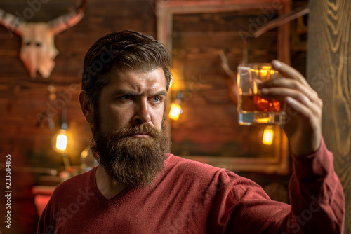 Fotografering  Barman with whisky or brandy