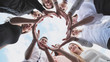 canvas print picture - A group of high school students look through the shape of a circle created from their palms. The concept of friendly friends.