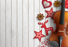 Violin And Christmas Ornaments On White Wood