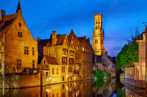 Bruges Bruges, Belgium. Evening sunset with blue sky. Water channels