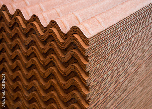 Fotografia, Obraz  A stack of ondulin sheets - a modern roofing material