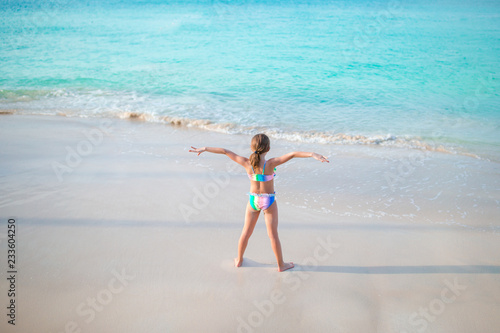 da24a9fc13f Cute little girl on the beach during caribbean vacation - Buy this ...