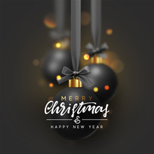 Christmas Background With Black Balls Hanging On Ribbon With Bows And Bright Sparkling Bokeh Lights.
