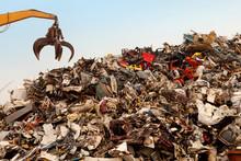 Cropped Image Of Crane Over Garbage Heap At Junkyard