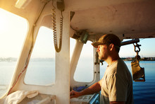 Fisherman Sailing Trawler In Sea